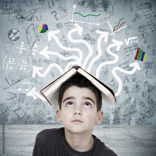 boy with book on his head overwhelmed by the chaos