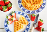 Fototapeta Crisp golden fresh baked waffle topped with strawberries on whit