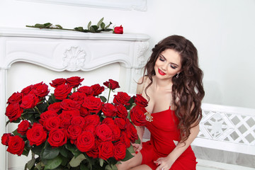 Beautiful happy brunette woman with red roses bouquet, valentine