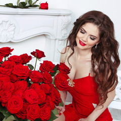 Beautiful smiling female with red roses bouquet, valentines day.