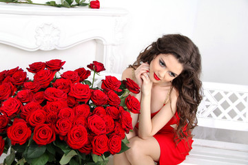 Happy Woman with red roses bouquet. Valentines day. Beautiful br