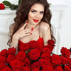 Valentine portrait of Beautiful brunette woman with red roses bo