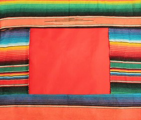 fiesta poncho rug stripe background with copy space