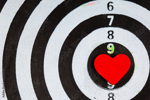 Black white target with heart bullseye as love background