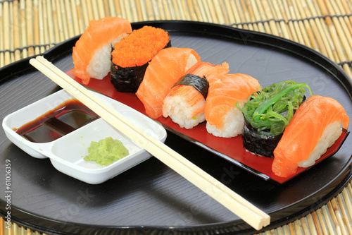 salmon,shrimp,seaweed sushi in the tray