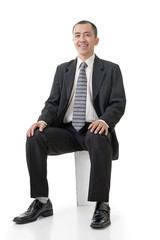 Friendly Asian business man sit