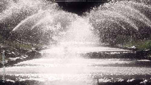 "Splashing water. Fountains on the ""EUR Park"" in Rome, Italy"