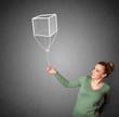 Woman holding a cube balloon