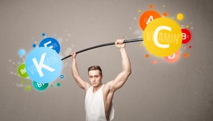 muscular man lifting colorful vitamin weights