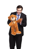 businessman with a teddy bear