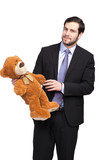 handsome businessman with teddy bear