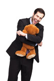 businessman hugging a teddy bear