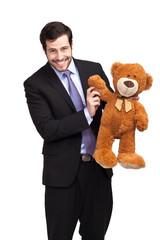 businessman with teddy bear saing hello