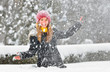 teenager girl play with snow