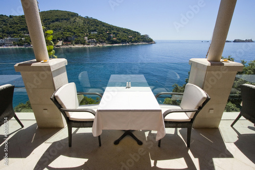 Table for two with sea view on restaurant terrace