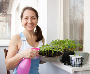 woman  grows vegetables