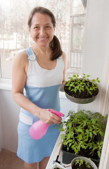 woman takes care of  seedlings