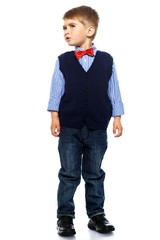 Little boy in blue vest with red bow tie