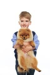 Little happy boy holding spitz