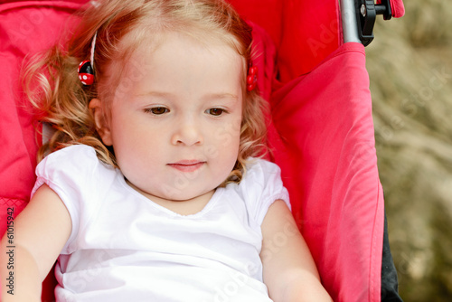 toddler in stroller