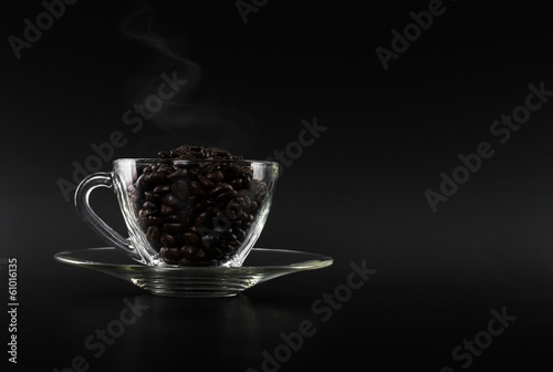 dark coffee beans on glass cup