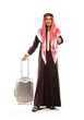 Young smiling arab with a suitcase isolated on white