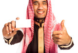 Young smiling arab showing business card in hand isolated on whi