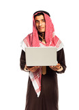 Young arab with laptop isolated on white background