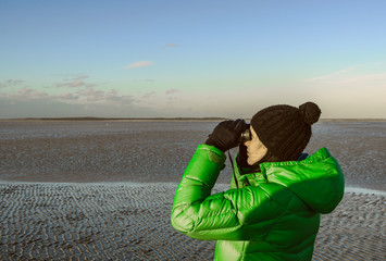Girl looking through binocular, Baie de Somme