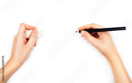 Human hands with pencil and erase rubber writting something. On