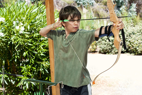 portrait of a child, archery, outdoor