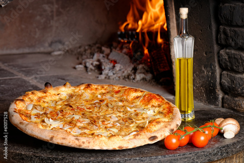 Hot Tuna pizza with oven fire on background