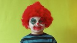 Kid clown dress up with red wig and make up