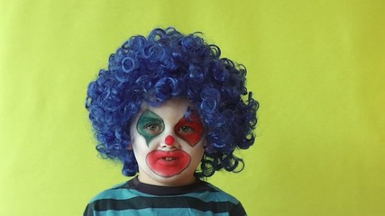 Happy kid dress up clown with blue wig and colour makeup
