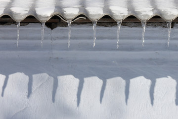 icicles on roof of building