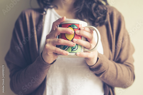 close up of hands woman with cup