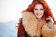 fashion portrait of a beautiful smiling girl with red hair in th