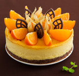 Delicious cheesecake with orange and chocolate.