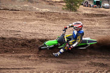 MX racer, with a large slope in gritty