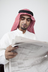 Arab man reading investment profit