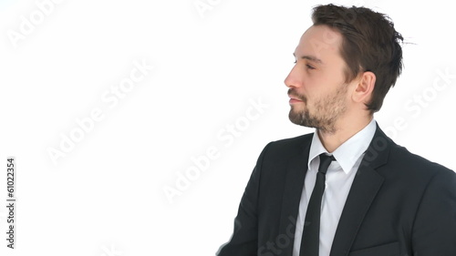 Handsome businessman writing on a virtual screen