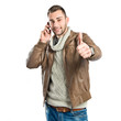 Young man smiling with a phone