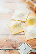 Homemade ravioli on wooden table