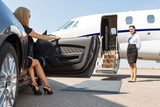 Elegant Woman Stepping Out Of Car At Terminal