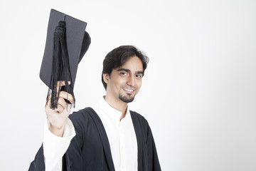 Asian student graduate raising his hat