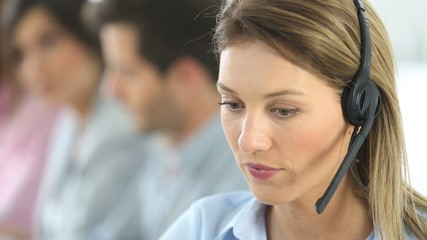 Sales representative woman with headset on