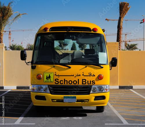 Fotobehang Dubai A front on view of a yellow Arabic school bus