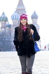 Young woman walking on the Red Square in Moscow