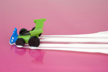 Toy car leaving trail of milk