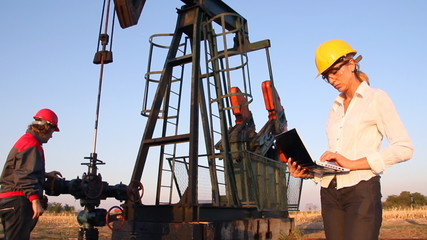 Workers in an Oil field, teamwork